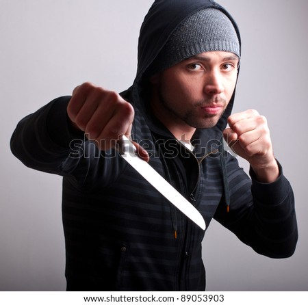 man with a knife - stock photo