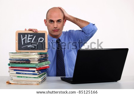 Man with a laptop asking for help - stock photo