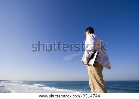 man with a laptop, ready to work outdoor (lots of copy space) - stock photo