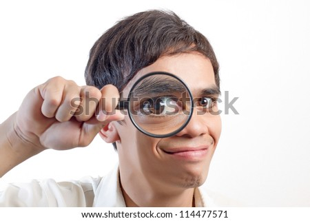 Man with a magnifying glass - stock photo