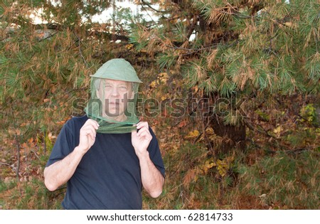 Man with a mosquito net - stock photo