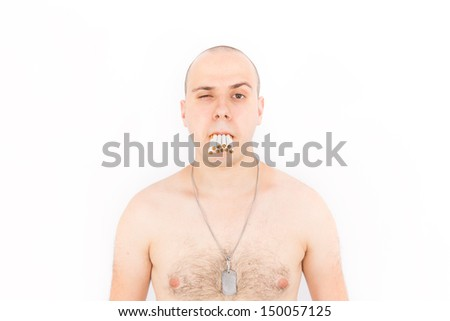 Man With a Mouth Full of Many Cigarettes - stock photo