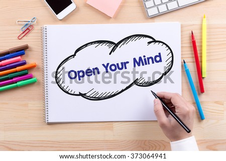 Man with a Notepad written Open Your Mind Concept - stock photo