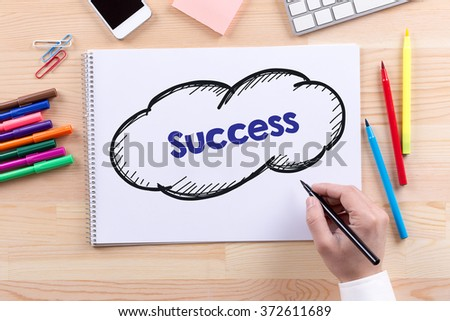 Man with a Notepad written Success Concept - stock photo