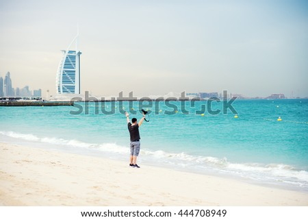 Man with a photo camera on the beach.