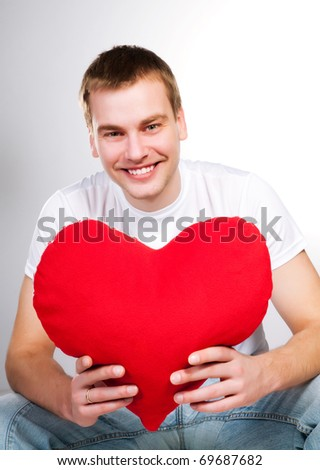man with a red heart on a white background