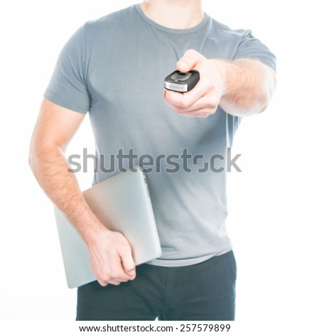 Man with a remote control from the car in the hands - stock photo