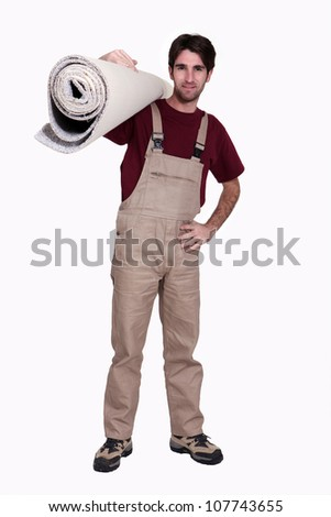 Man with a roll of carpet - stock photo