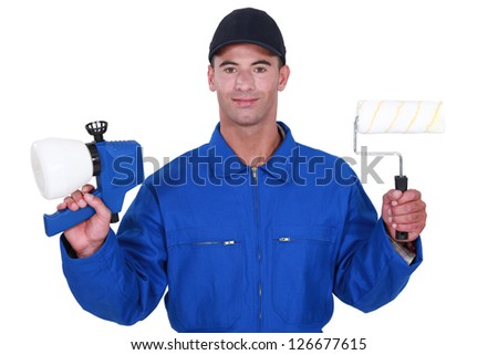 Man with a roller and paint gun - stock photo