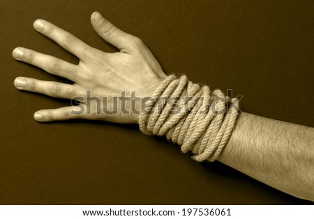 Man with a rope in his hand. Sepia tone. Horizontal