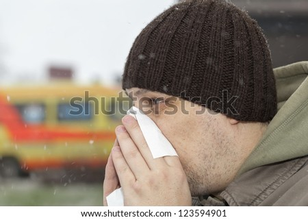 Man with a runny noise near the hospital - stock photo
