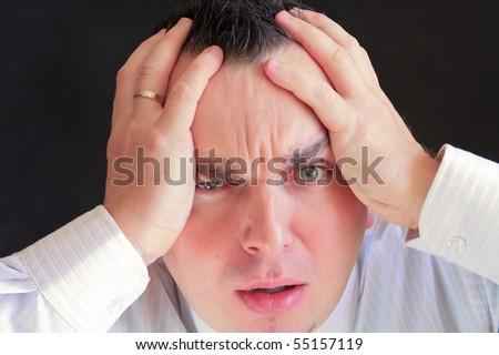 Man with a sad face - stock photo