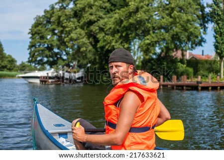Man with a seious look in a boat