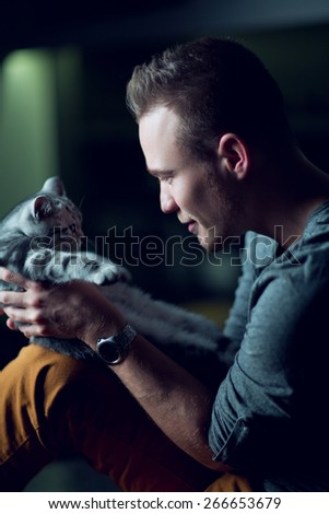 Man with a small kitten - stock photo