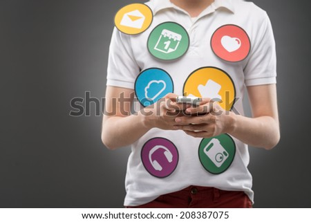 Man with a smartphone using social media - stock photo