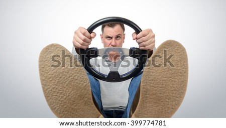 Man with a steering wheel, front view. Driver car concept - stock photo