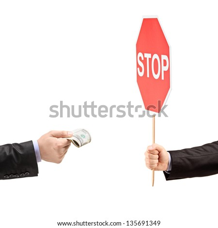 Man with a stop sign saying no to bribery, isolated on white background - stock photo