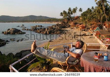 man with a video camera in Goa - stock photo
