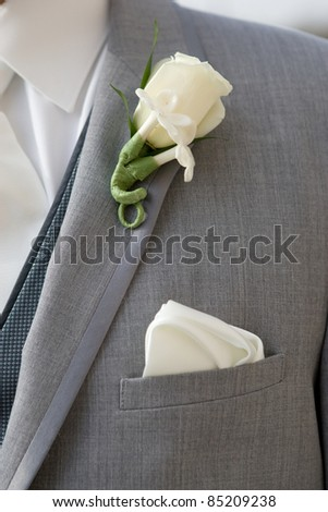 Man with a white flower on his lapel