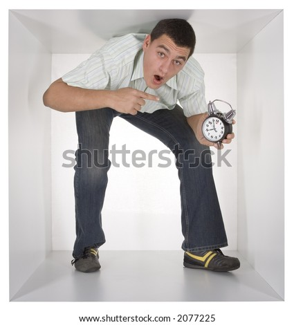 man with alarm clock in the cramped white cube