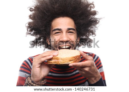 Man with an afro eating a sandwich - stock photo