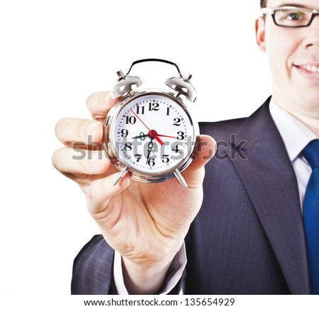 man with an alarm clock in a hand closes his eyes . Isolated on white background idea and concept of the schedule of the daily routine, not enough sleep worker