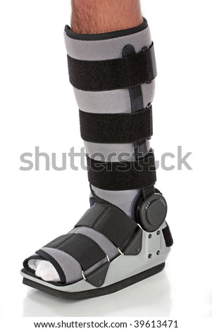 Man with an ankke brace over white - stock photo