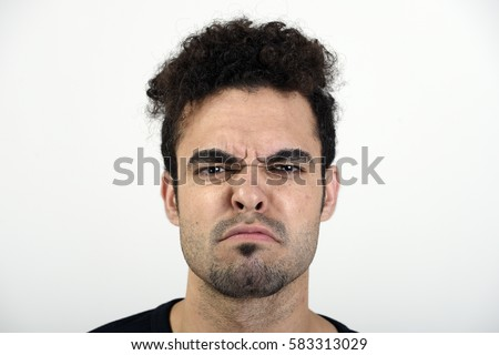 Man with an unhappy expression