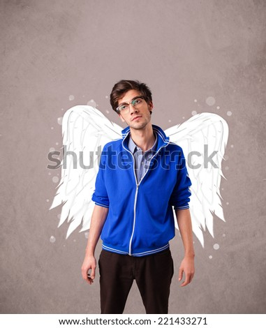 man with angel illustrated wings on grungy background - stock photo