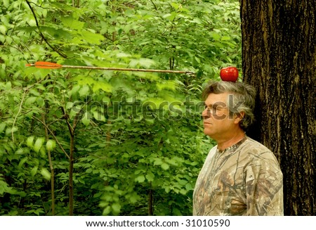 man with apple on head with arrow approaching - stock photo