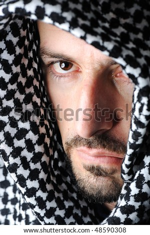 Man with arabic palestinian colors - stock photo
