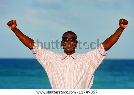 Man with arms extended - stock photo