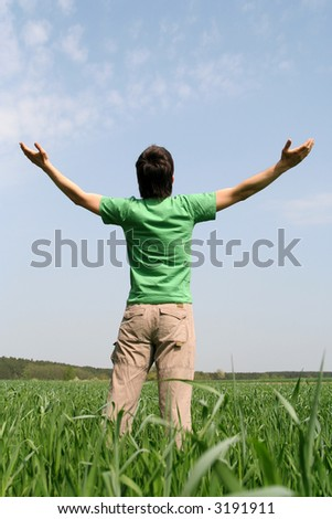 Man with Arms Outstretched - stock photo