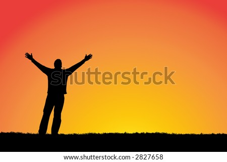 Man with arms stretched out to a sunset sky. - stock photo