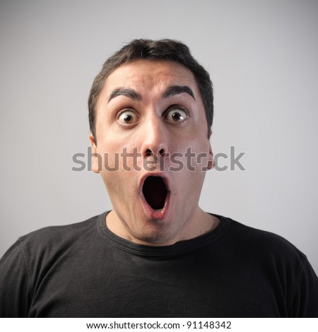 Man with astonished expression - stock photo