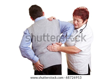 Man with back problems seeing a female doctor - stock photo