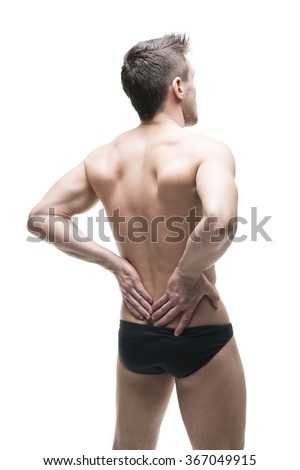 Man with backache. Pain in the human body. Isolated on white background - stock photo