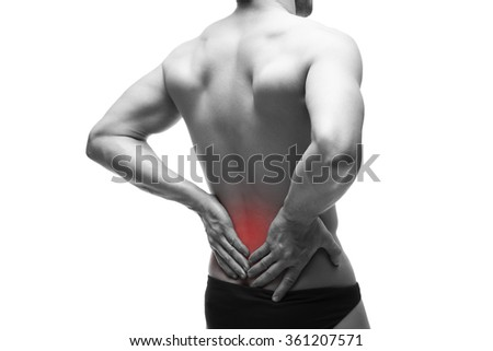 Man with backache. Pain in the muscular human body. Isolated on white background. Black and white photo with red dot - stock photo