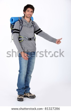 Man with backpack hitchhiking - stock photo