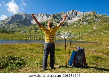 man with backpack in mountain - stock photo