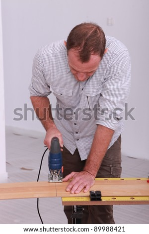 Man with band saw