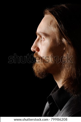 man with beard and long hairs, profile portrait