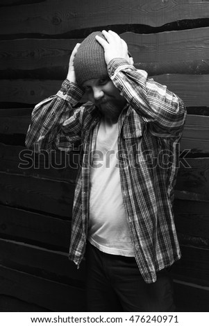 Man with beard holding his head. Headache. Black and white photo.
