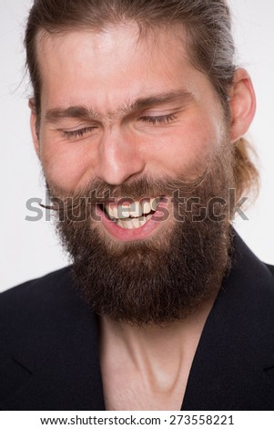Man with beard laugh sincerely on white background