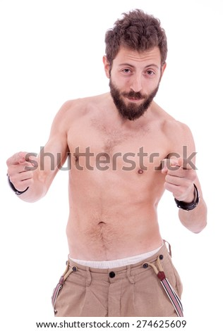 Man with beard posing naked to the waist in front of the camera