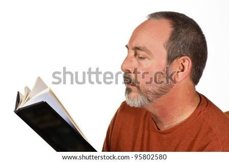 man with beard reading a book isolated - stock photo