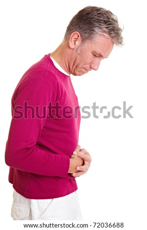 Man with bellyache holding his aching stomach - stock photo