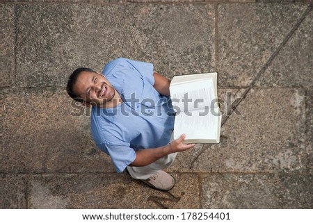 Man with Bible looking up - stock photo