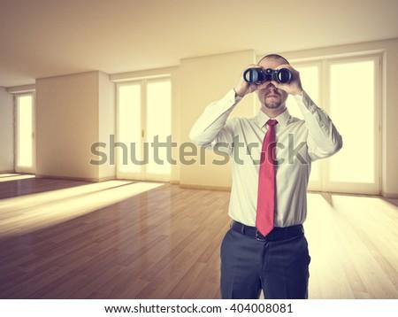 man with binoculars and 3d interior - stock photo