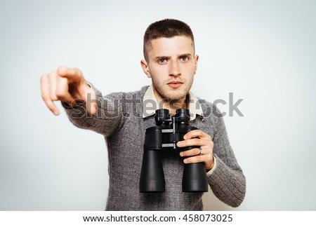 man with binoculars. gray background - stock photo